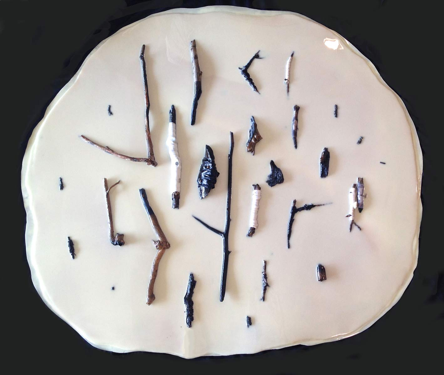 Artifacts, breast milk, resin, charred sticks, ribbon, tacks, 54 inches in diameter, 2016
