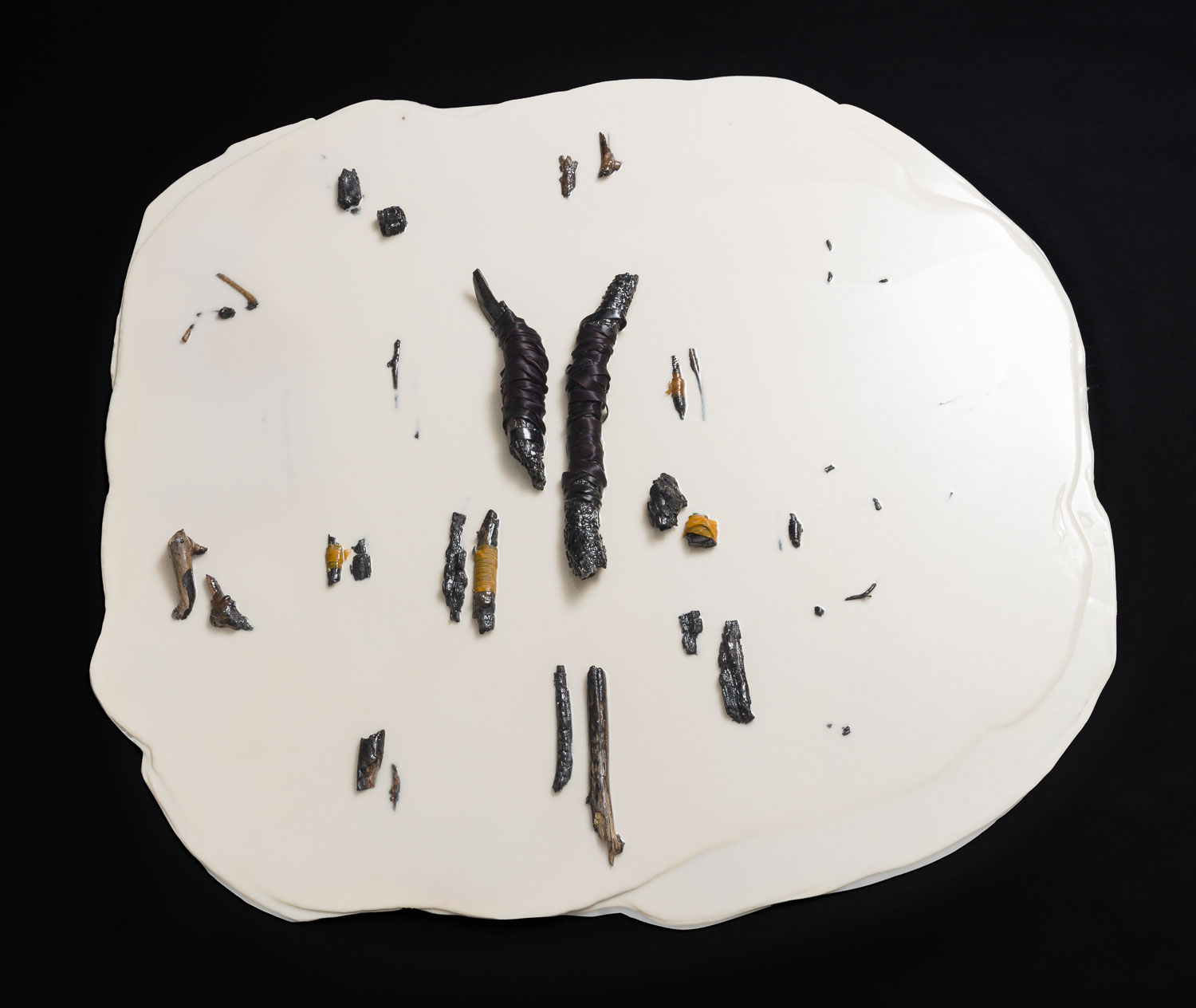 Pairs, 54 inches in diameter, breast milk, acrylic paint, charred sticks, mixed media, 2016