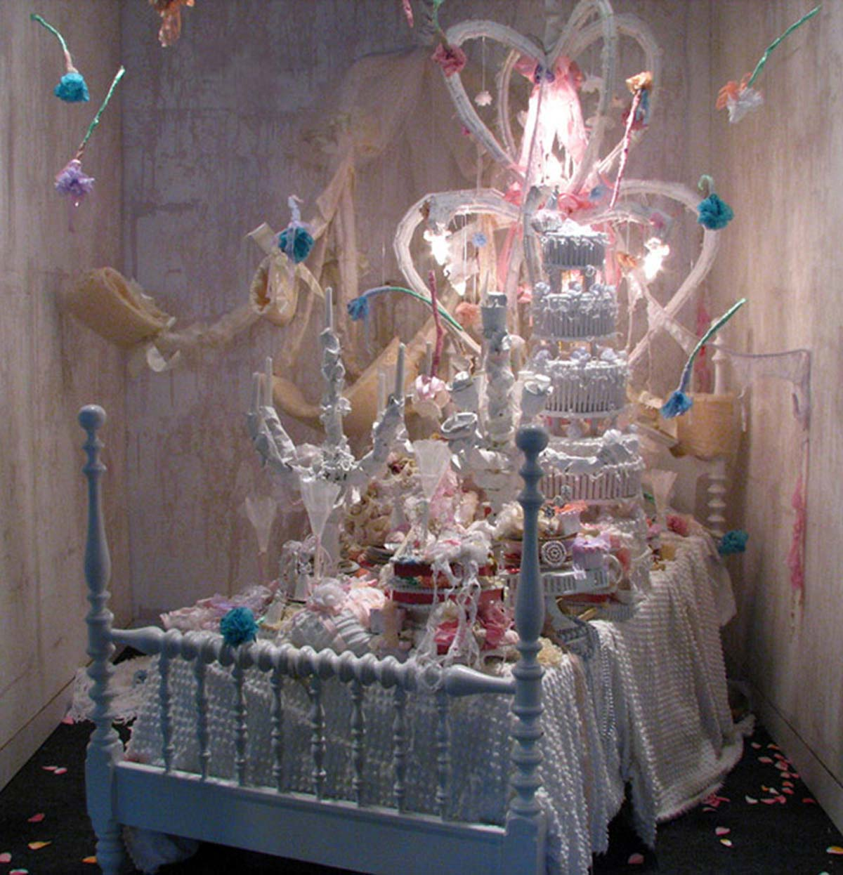 Reception, dimensions vary (roughly 8x10'), bed, wedding dress, tampons, birth control pills, underwear, candles, wax paper, plates, chocolate, ribbon, chenille bedspreads, paint, mixed media, 2009